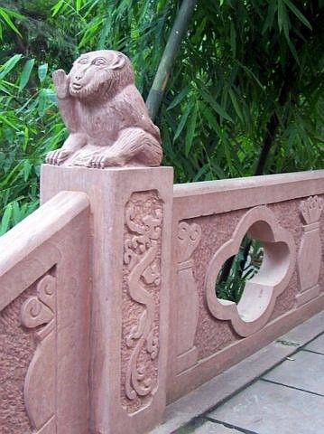 QingYang gong temple - Balustrade with a speaking monkey