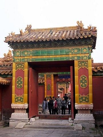 Forbidden city - One of the many doors with glazed terracotta decorations