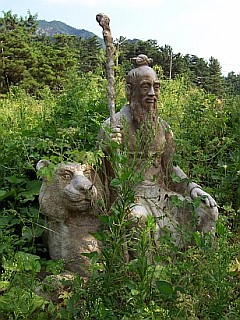 Statue of the spirit of the mountain with a tiger
