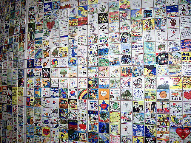 Some of the tiles of the wall of Hope