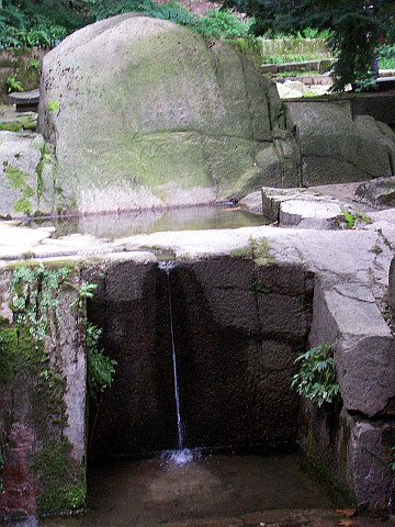 Changdeokgung palace - Flow of water in front of a rock