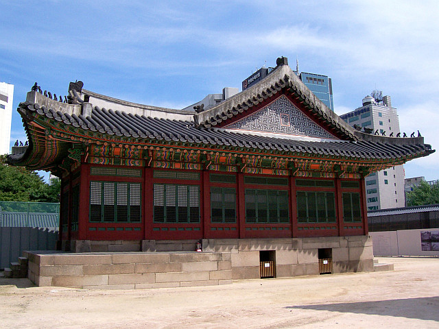 Deoksugung palace - Old hall in front of modern buildings