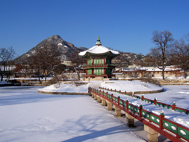 Gyeongbokgung palace - Hyangwonjeong pavilion seen from the footbridge in winter