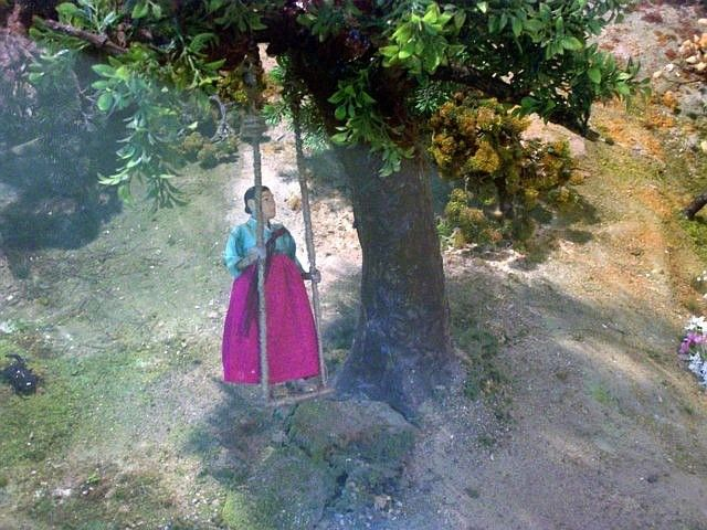 Yong-in folk village - Model of a lady on a swing