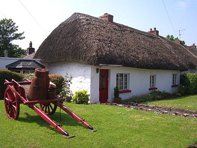 Thatched house with tip-up cart