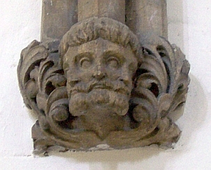 Llandaff cathedral - Three faces representing the Holy Trinity